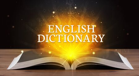 ENGLISH DICTIONARY inscription coming out from an open book, educational concept