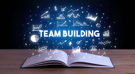 TEAM BUILDING inscription coming out from an open book, business concept