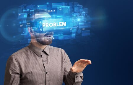 Businessman looking through Virtual Reality glasses with PROBLEM inscription, innovative security concept