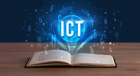 ICT inscription coming out from an open book, digital technology concept