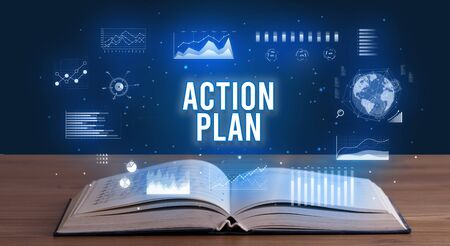 ACTION PLAN inscription coming out from an open book, creative business concept