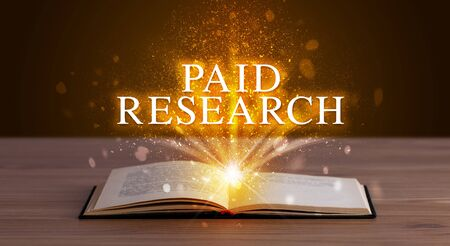 PAID RESEARCH inscription coming out from an open book, educational concept
