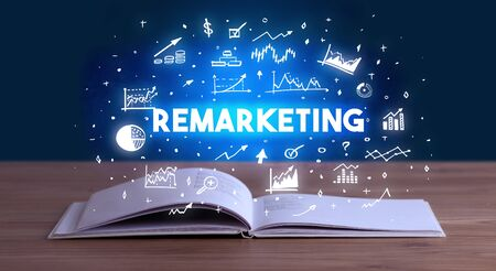 REMARKETING inscription coming out from an open book, business concept