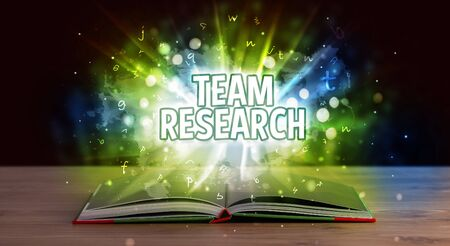 TEAM RESEARCH inscription coming out from an open book, educational concept Stock fotó - 133616026
