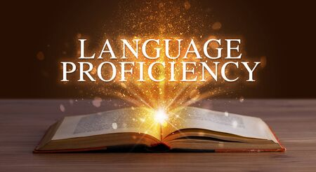 LANGUAGE PROFICIENCY inscription coming out from an open book, educational concept Stock fotó - 133616033