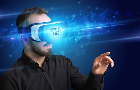 Businessman looking through Virtual Reality glasses with DIGITAL LIFE inscription, cyber security concept Stock Photo