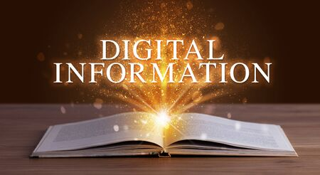 DIGITAL INFORMATION inscription coming out from an open book, educational concept Stock fotó