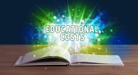 EDUCATIONAL COSTS inscription coming out from an open book, educational concept Stock fotó