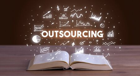 OUTSOURCING inscription coming out from an open book, business concept Stock fotó - 133616189