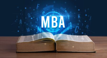 MBA inscription coming out from an open book, digital technology concept