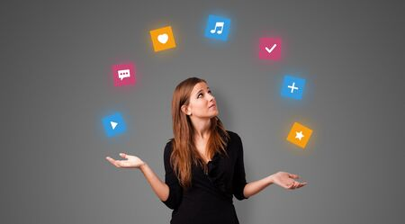 Young person juggle with application icons Zdjęcie Seryjne