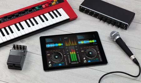 Mixing music on tablet with electronic music instruments concept
