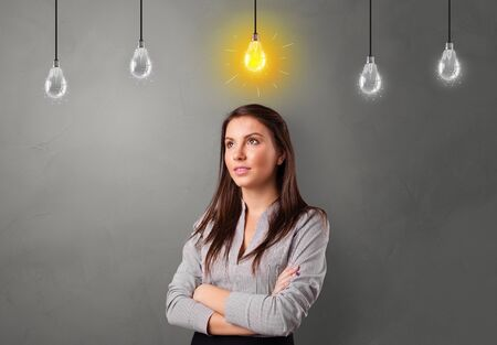 Young student looking for new idea with lighting bulb concept Banco de Imagens