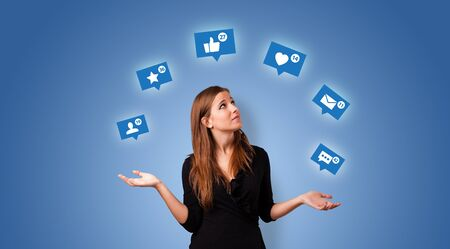 Young person playing with social media symbols Stok Fotoğraf