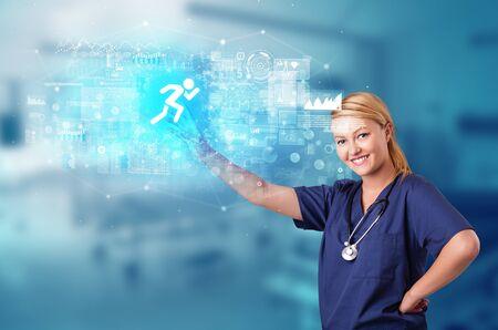 Doctor touching hologram screen displaying healthcare running symbols 版權商用圖片 - 134841216