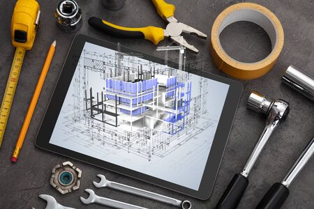 Tablet with construction tools and 3d house plan concept 版權商用圖片