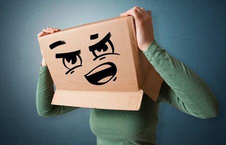 Man with cardboard box head Standard-Bild - 134841265