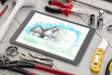 Tablet with construction tools and house plan concept 版權商用圖片