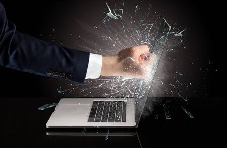 Strong arm boxing laptop screen strongly Reklamní fotografie