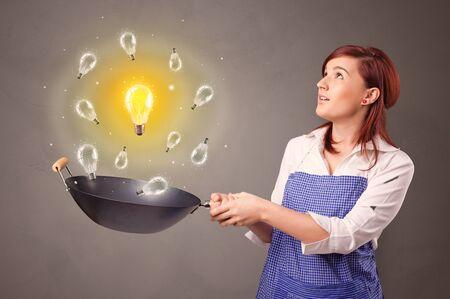 Smiling person cooking new idea concept Reklamní fotografie