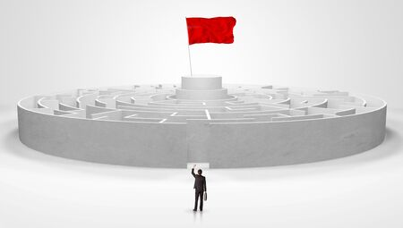 Man standing in front of a big round maze with flag