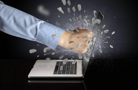 Strong male hand breaks laptop screen Reklamní fotografie