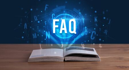 FAQ inscription coming out from an open book, digital technology concept