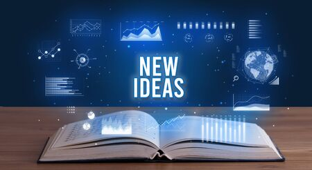 NEW IDEAS inscription coming out from an open book, creative business concept