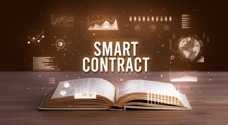 SMART CONTRACT inscription coming out from an open book, creative business concept Stock fotó