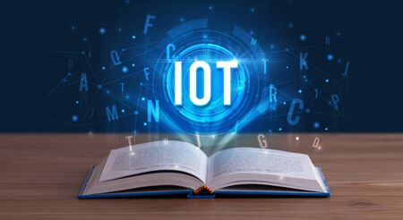 IOT inscription coming out from an open book, digital technology concept Stock fotó