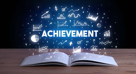 ACHIEVEMENT inscription coming out from an open book, business concept