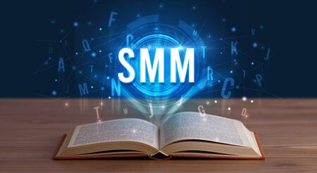 SMM inscription coming out from an open book, digital technology concept Stock fotó