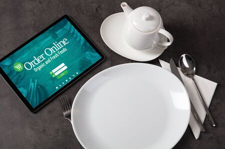Tablet with online order concept on a lain table