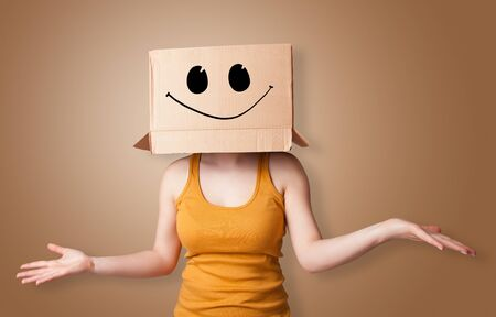 Man with cardboard box head Standard-Bild - 135244541
