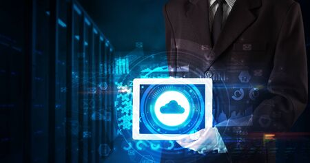 Hand holding tablet with cloud technology and dark concept Standard-Bild