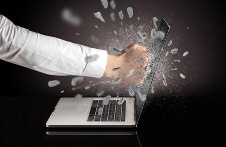 Strong male hand breaks laptop screen Stok Fotoğraf