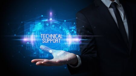 Man hand holding TECHNICAL SUPPORT inscription, technology concept