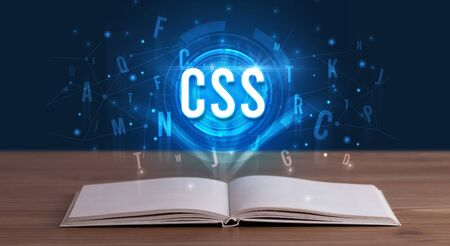 CSS inscription coming out from an open book, digital technology concept
