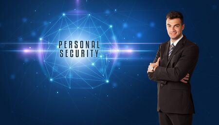 Businessman thinking about security solutions with PERSONAL SECURITY inscription Banque d'images