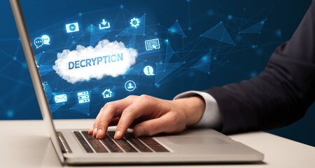 Businessman working on laptop with DECRYPTION inscription, modern technology concept
