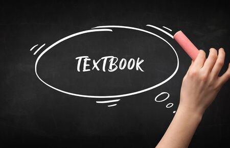 Hand drawing TEXTBOOK inscription with white chalk on blackboard, education concept Stock Photo