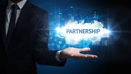 Hand of Businessman holding PARTNERSHIP inscription, successful business concept Banco de Imagens