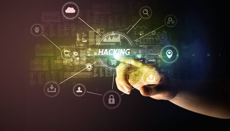 Hand touching HACKING  inscription, Cybersecurity concept