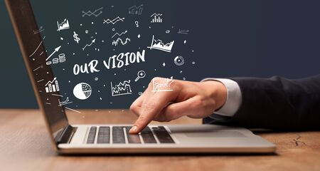 Businessman working on laptop with OUR VISION  inscription, modern business concept
