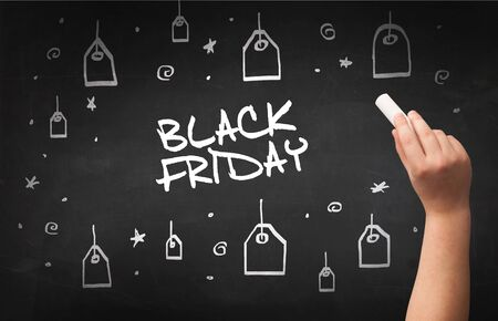 Hand drawing  BLACK FRIDAY inscription with white chalk on blackboard, online shopping concept 写真素材