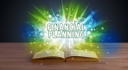 FINANCIAL PLANNING inscription coming out from an open book, educational concept Reklamní fotografie