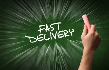 Hand drawing  FAST DELIVERY inscription with white chalk on blackboard, online shopping concept
