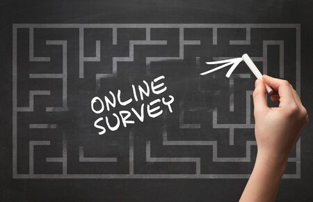 Hand drawing  ONLINE SURVEY inscription with white chalk on blackboard, new business concept