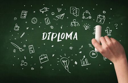 Hand drawing  DIPLOMA   inscription with white chalk on blackboard, education concept Stock Photo
