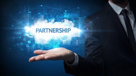 Hand of Businessman holding PARTNERSHIP inscription, successful business concept Imagens